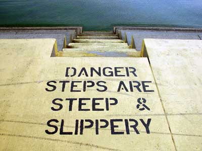 Warning painted on slippery steps