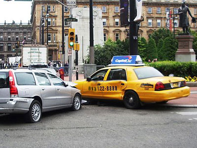 Photo of a Wrecked Taxi from a Traffic Collision