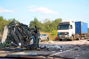 Photo of a large truck accident on highway with significant damage and injuries